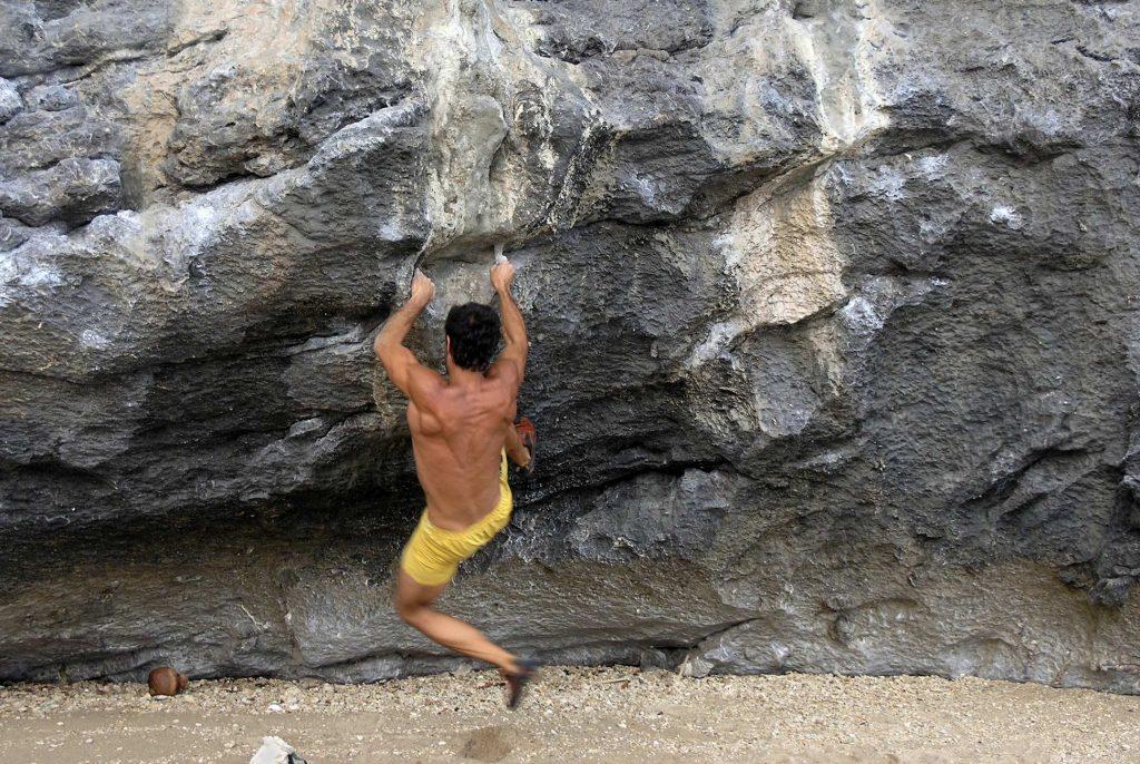 Rock climber making an ascent in Krabi