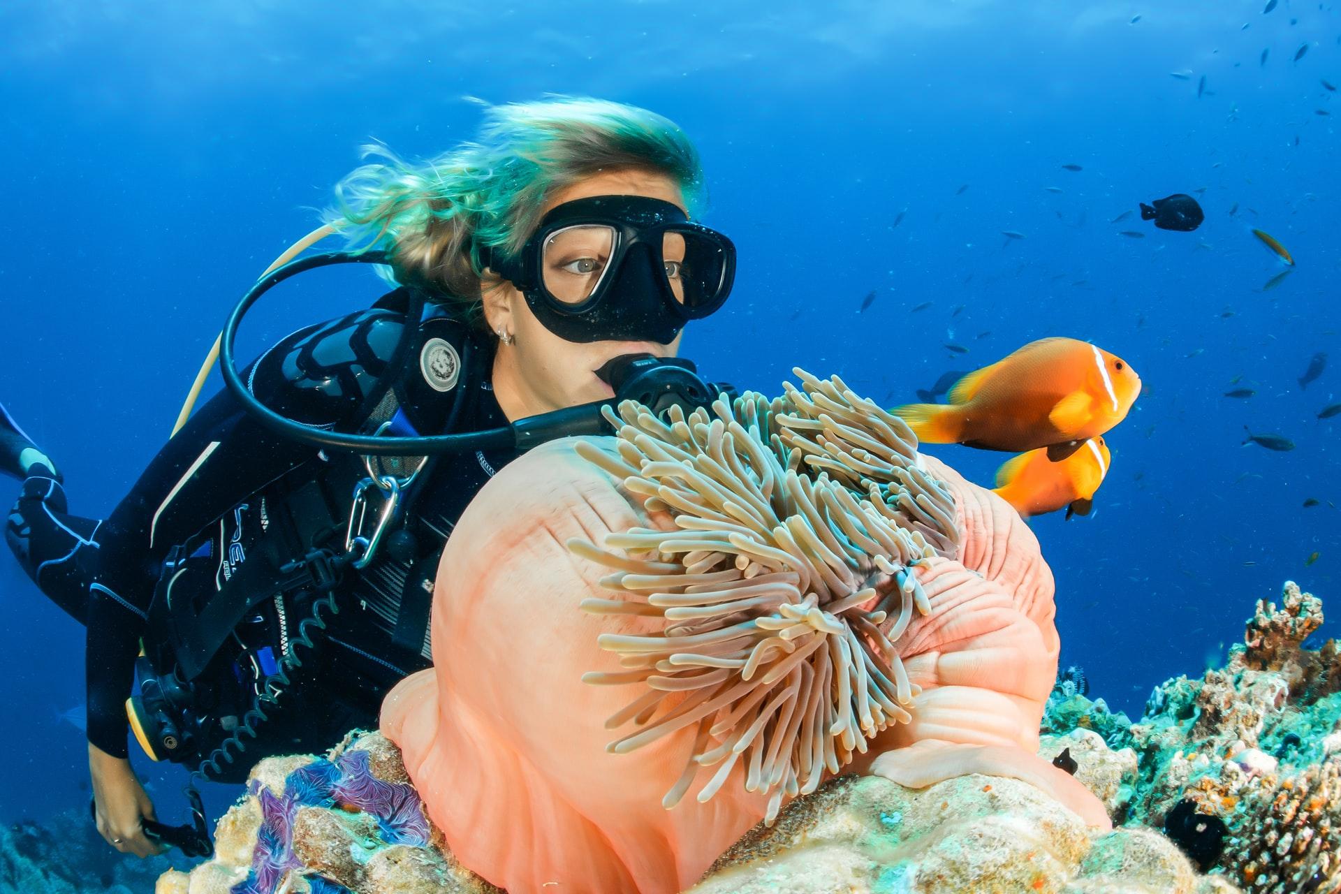 A female scuba diver in Koh Tao, Thailand