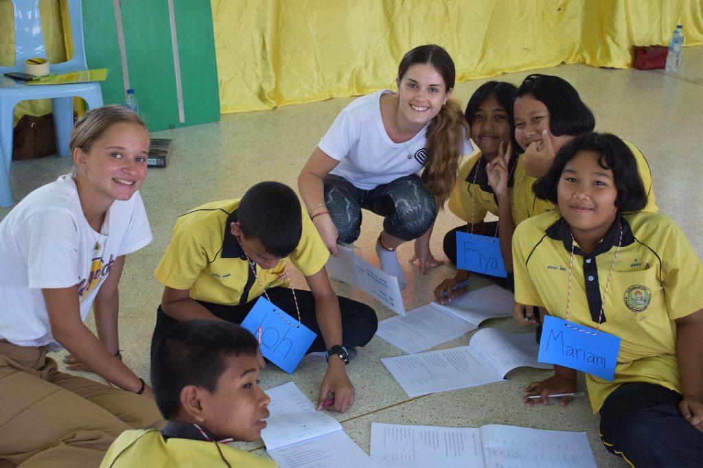 English-speaking volunteers teach a language class at a Thai school in Khao Lak, Thailand
