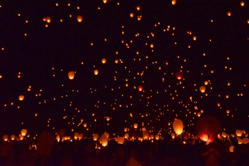 Lanterns are being launched into the night sky during Loy Krathong festival in Chiang Mai, Thailand