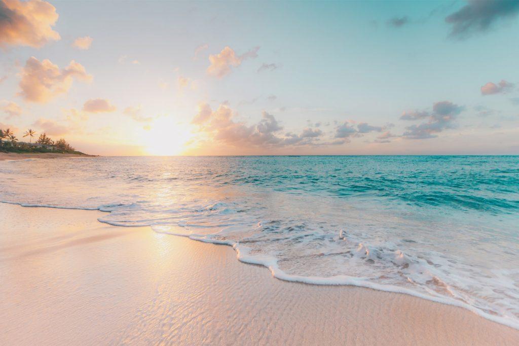The sun rises over a beach in Thailand