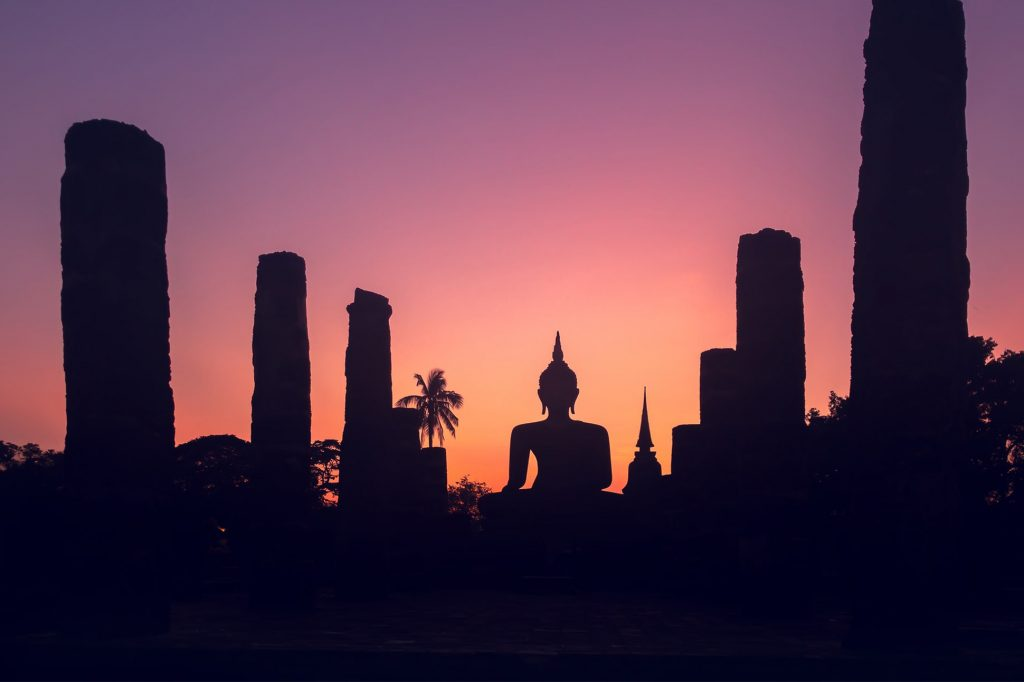 The sun sets over a temple in Sukhothai, Thailand