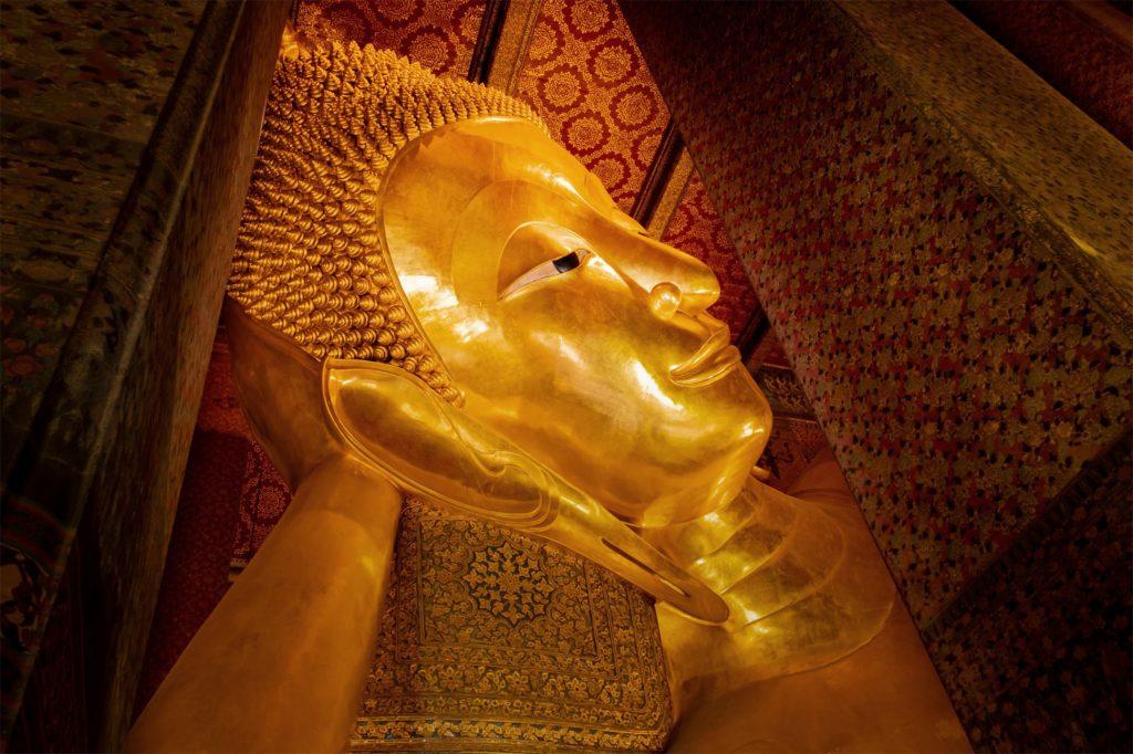 The reclining Buddha statue at Wat Pho, Bangkok, Thailand