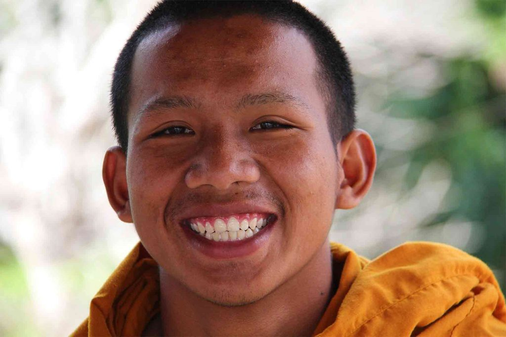 Monk is all smiles in a village in Thailand